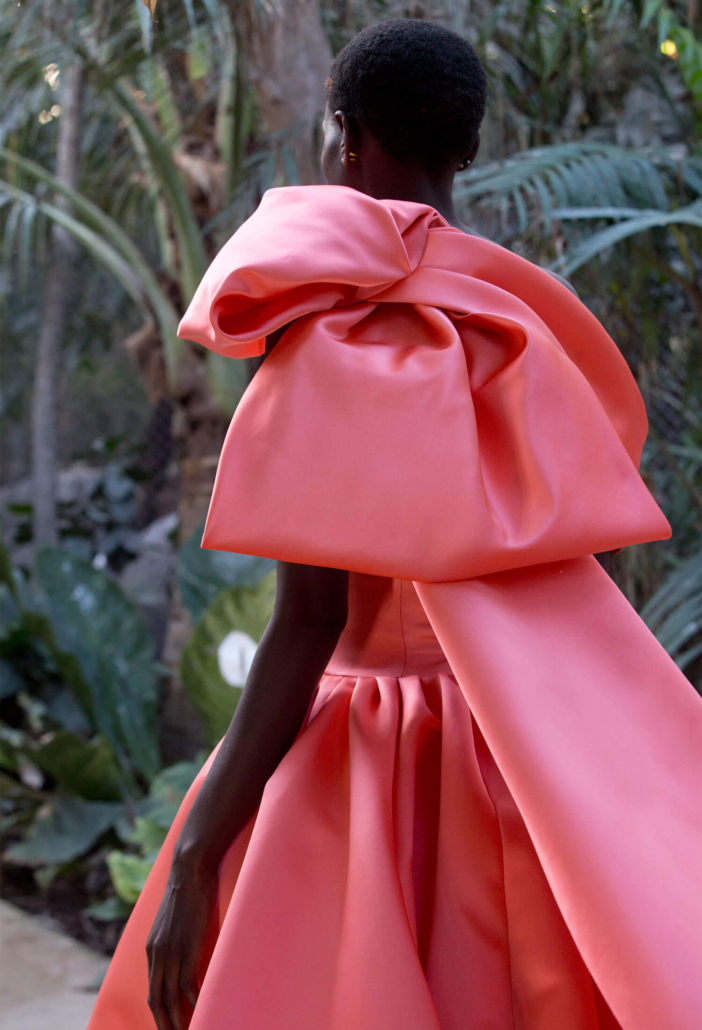 model with a coral dress made by Ashi