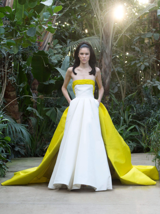 model in a garden with a white and yellow dress made by Ashi
