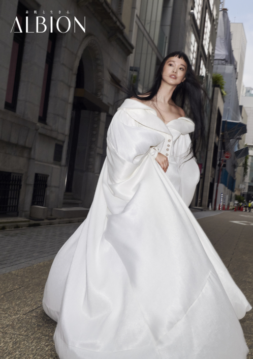 the model Mannami Yuka wears a white dress made by Ashi for Albion